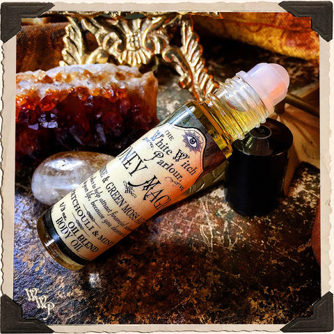 MONEY MAGICK Elixir 1/3oz. BODY OIL Rollon. Scent of Patchouli & Mint. Blessed by Citrine & Green Moss Agate Crystals.