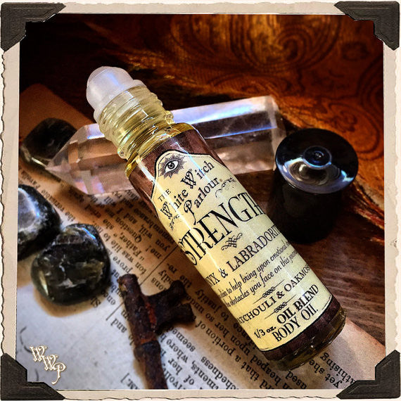 STRENGTH Elixir 1/3oz. Body Oil Rollon. Patchouli & Oakmoss. Blessed with Labradorite & Onyx Crystals.