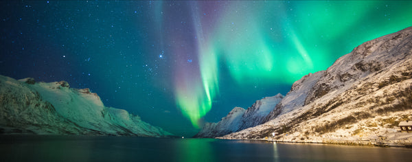 Northern Lights Shining Above Lake And Mountains