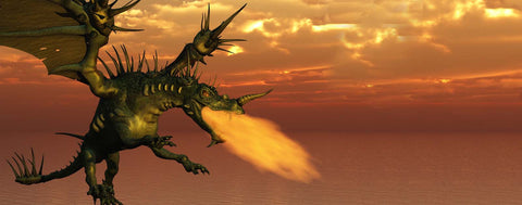 Flying Fire Breathing Dragon At Sunset