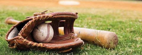 Baseball, Glove, and Bat on the Field