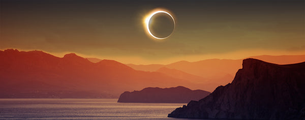Eclipse Over Mountain and Sea