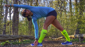 Woman stretching in zensah tech+ compression socks
