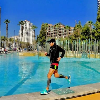 Man running in Zensah Featherweight Compression Leg Sleeves