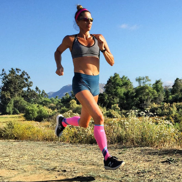 Female runner wearing Zensah racey sports bra in heather grey