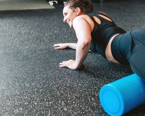 woman foam rolling after exercise