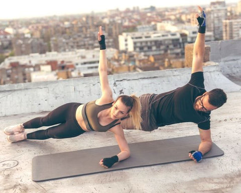man and woman doing plank and strength workouts