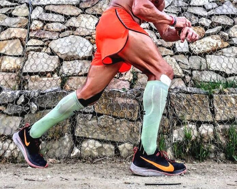 athlete wearing zensah tech+ compression socks