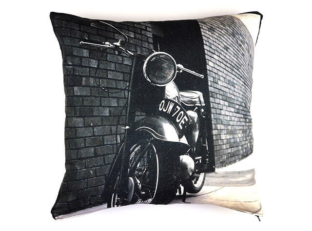 Handmade vintage motorbike print cushion on a white background