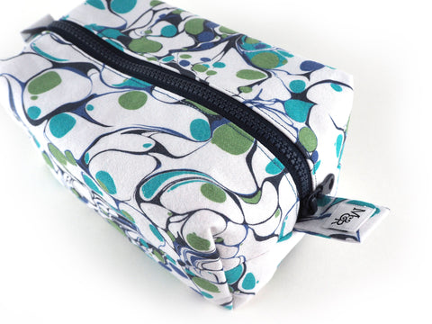 Handmade marble print box shaped wash bag in shades of blue green