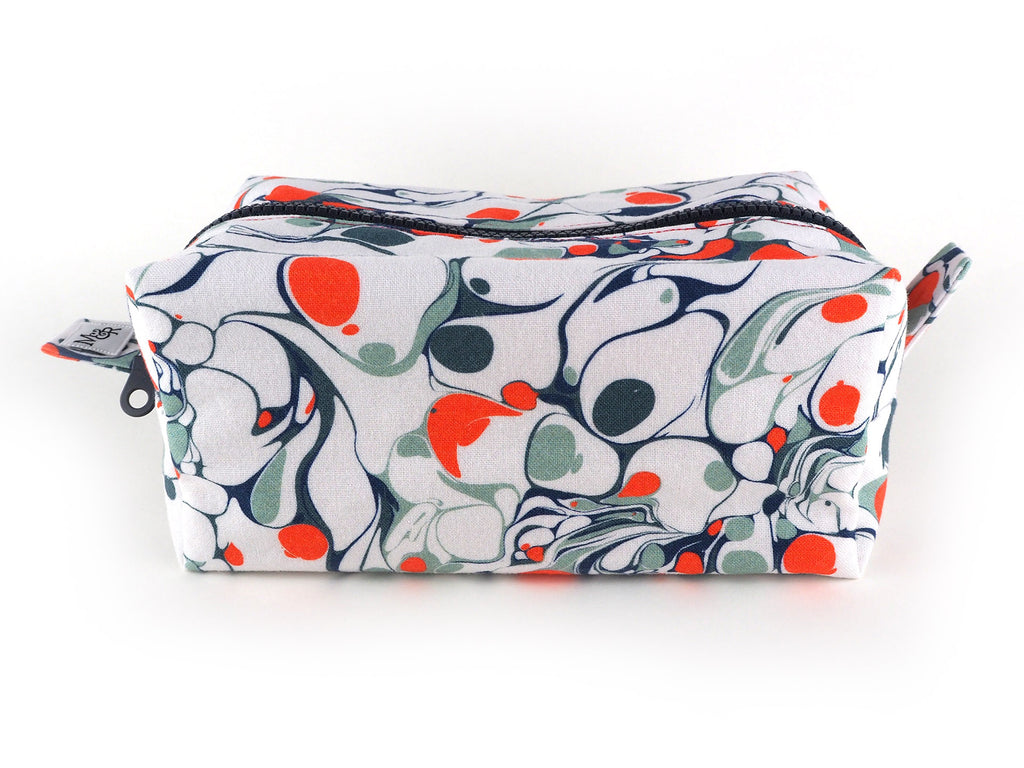 Handmade box shaped wash bag in bright orange and grey marble print