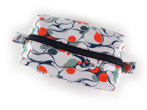 Handmade box shaped wash bag in orange and grey marble print