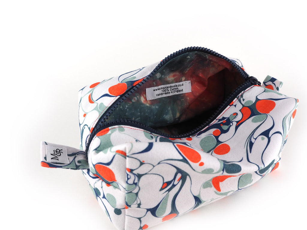 Handmade box shaped wash bag in marble print with hand dyed cotton lining