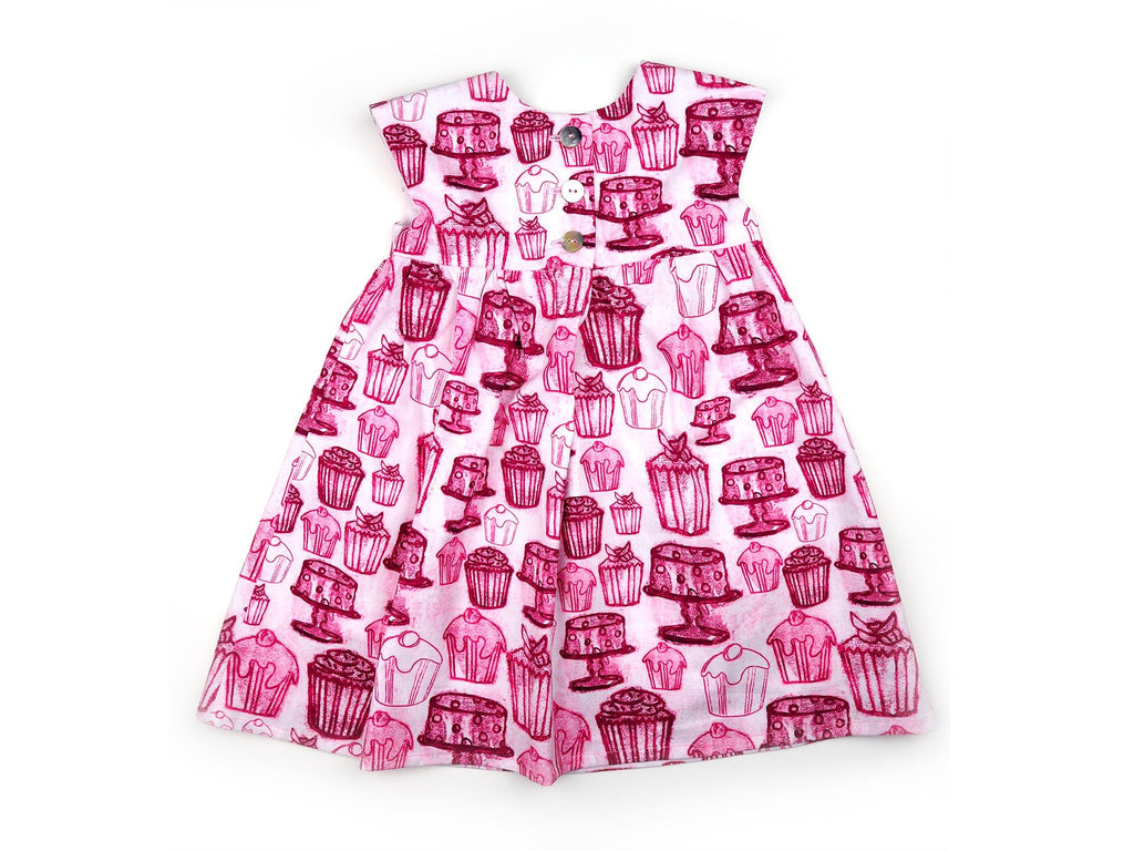 Back view of handmade girl's dress in cupcake print fabric
