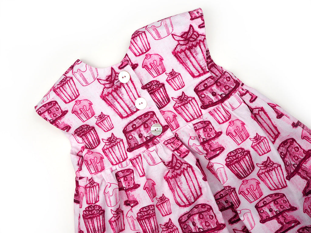 Handmade dress in pink and white cake print