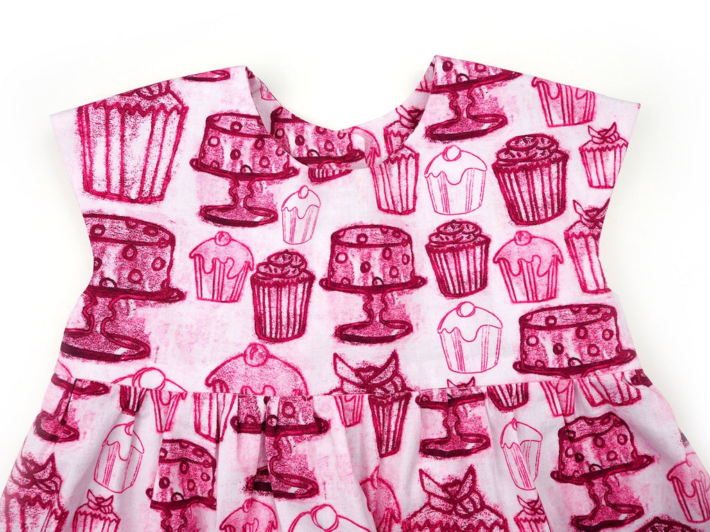 Close up of handmade girl's dress in cupcake print fabric