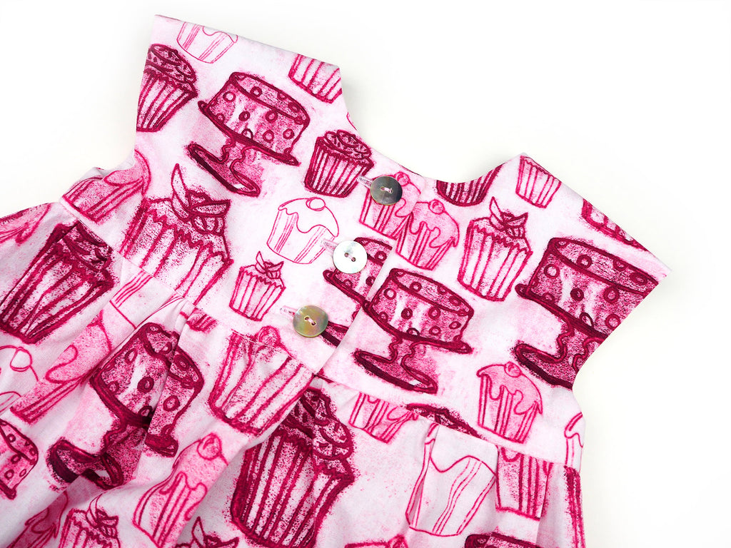 Detail of button closure on handmade girl's dress