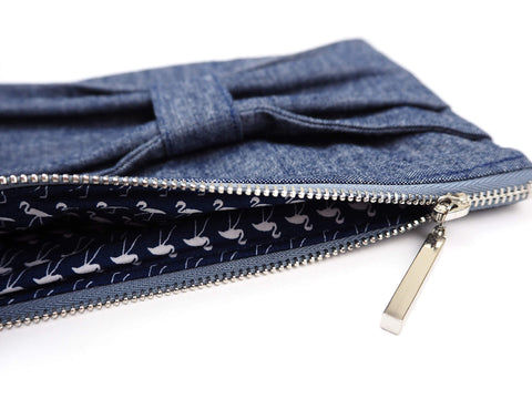 Close up of bow detail denim bag