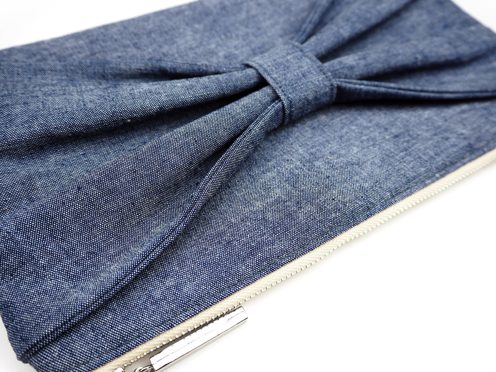 Handmade denim clutch bag with bow detail