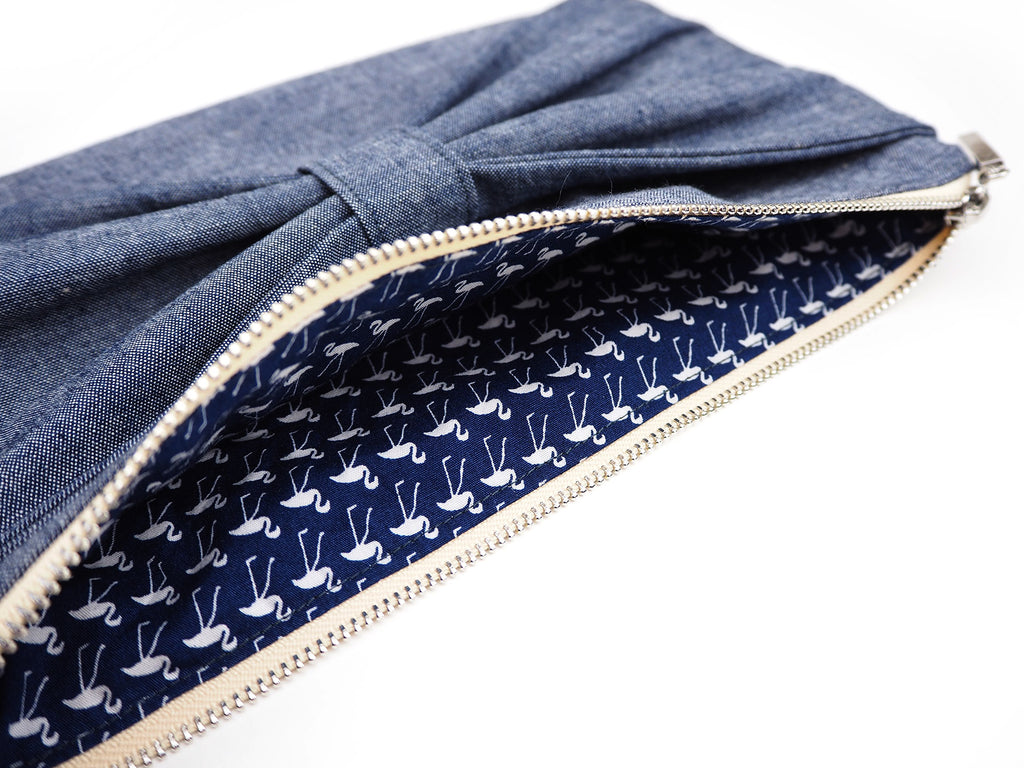 Handmade denim clutch bag with flamingo print lining