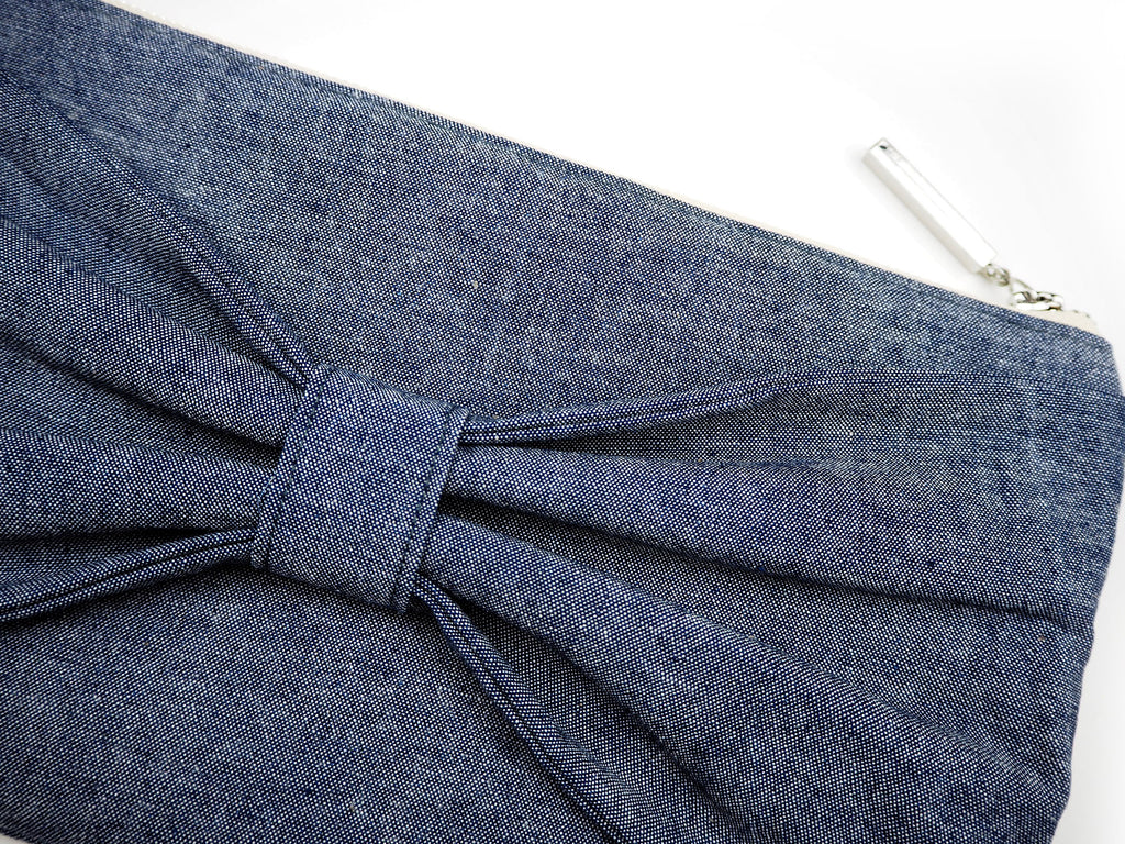 Handmade denim clutch bag with bow detail close up