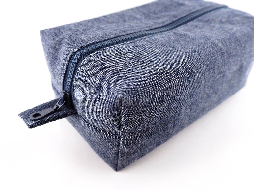 Handmade denim travel bag with chunky zip