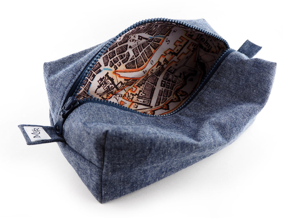Handmade denim travel bag with map print lining