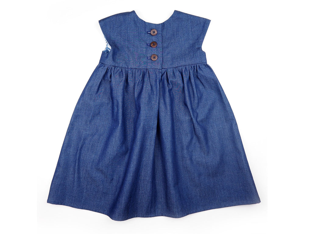 Back view of a handmade denim girl's dress with gathered skirt