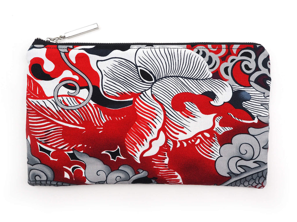 Handmade bow detail clutch bag in alexander henry fabric