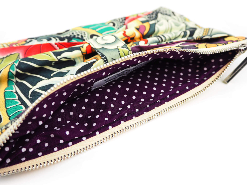 Handmade clutch bag in designer fabric with purple lining