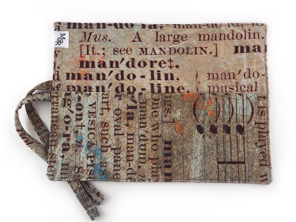 Handmade brush and pencil roll in text print fabric