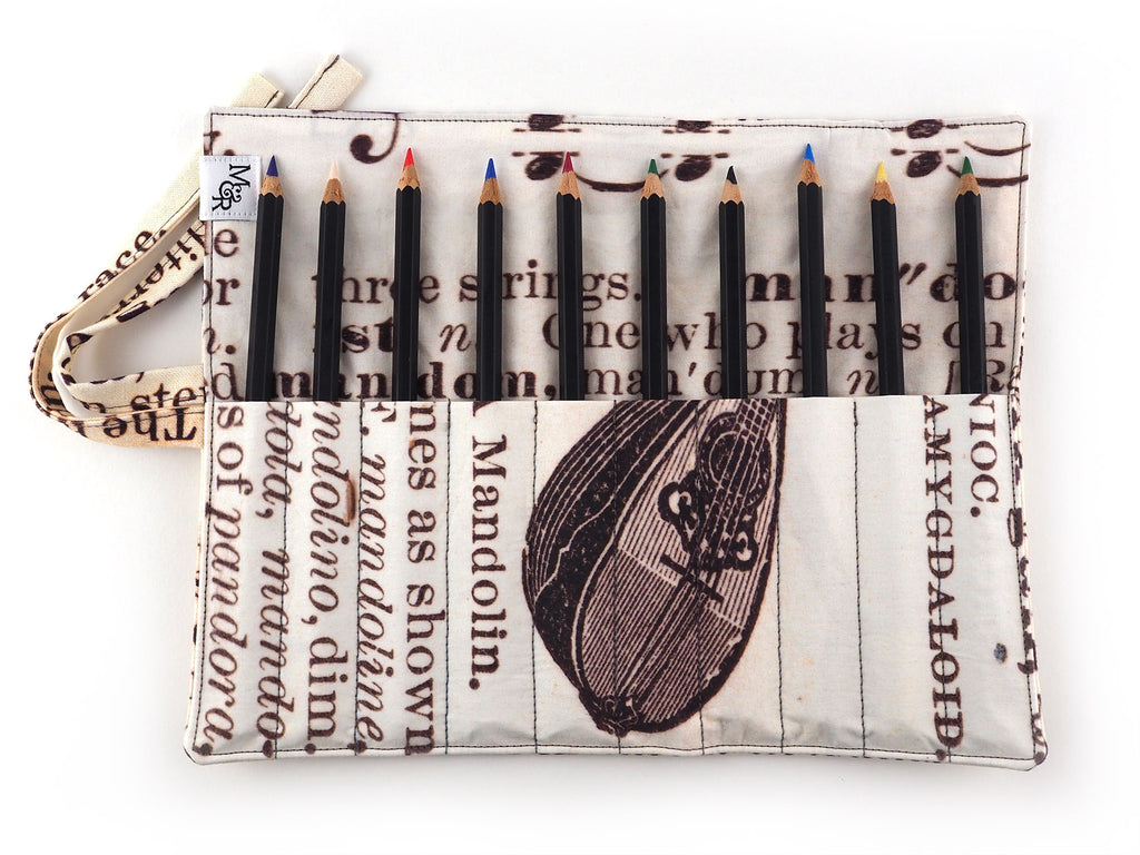 Handmade antique text print pencil roll inner