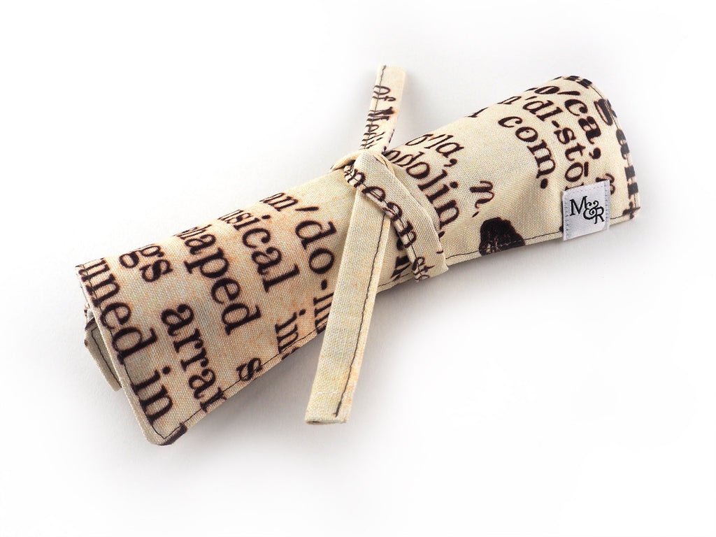 Handmade antique text print pencil roll