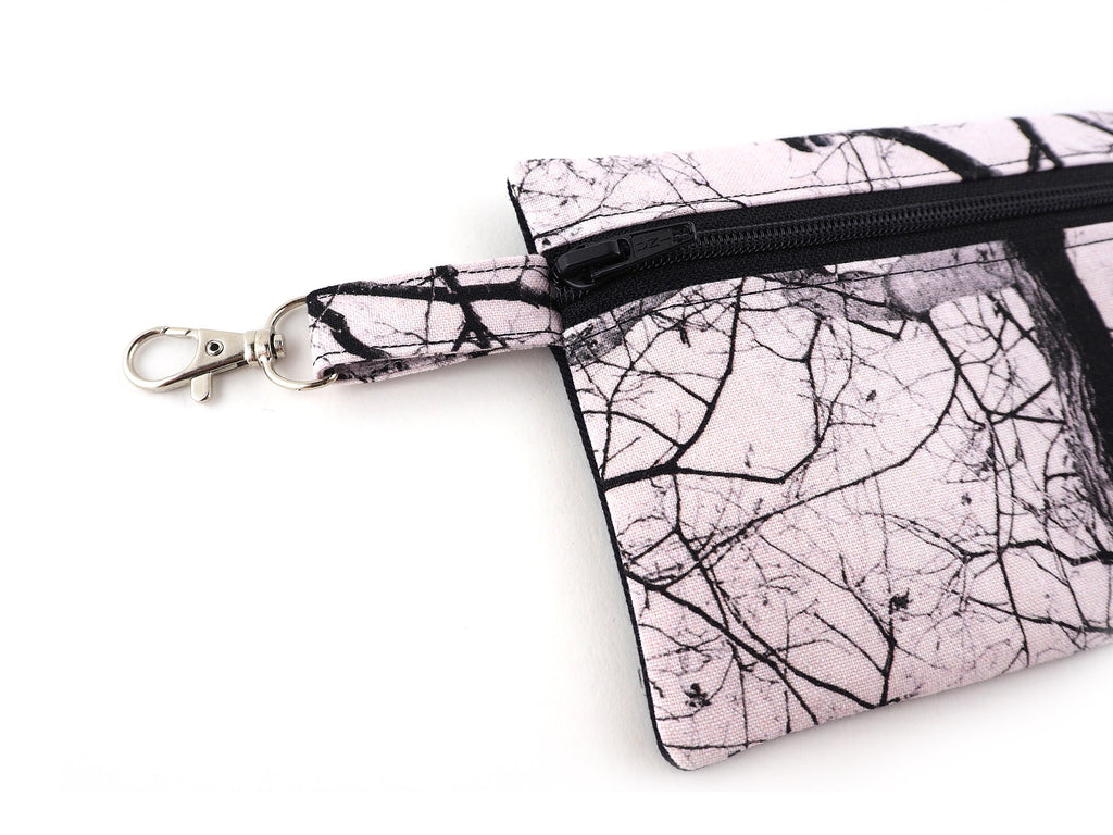 Handmade zipper pouch in tree print fabric with clasp