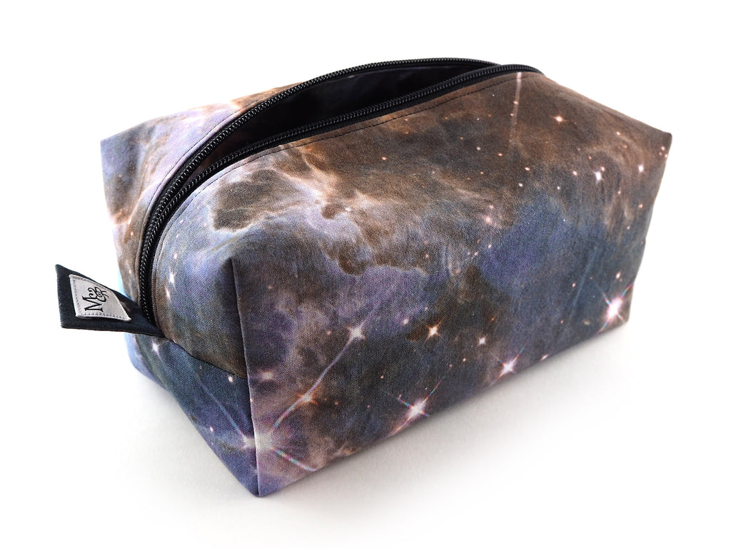 Handmade photographic star print storage bag with black zip