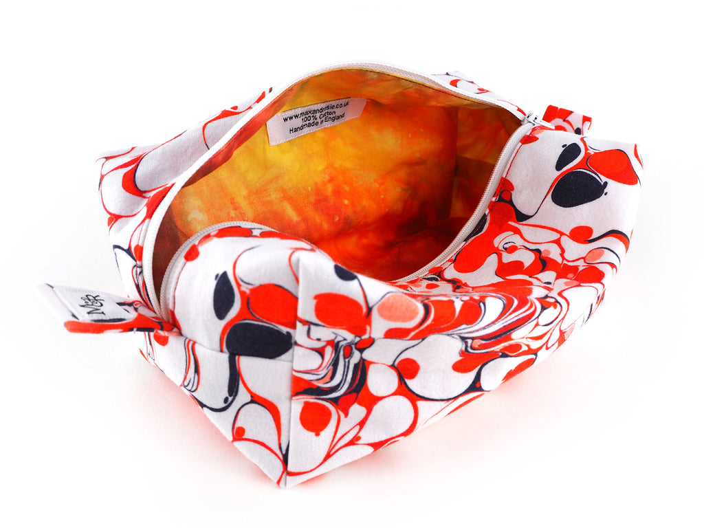 Handmade red marble print box shaped wash bag with orange and red lining
