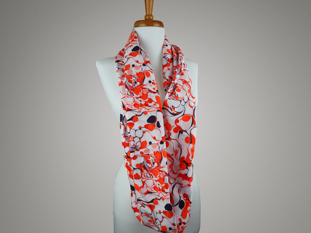 Handmade red and white marble print infinity scarf on a mannequin