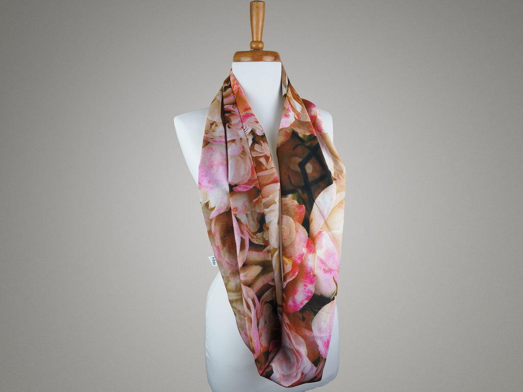 Handmade pink rose print infinity scarf on a mannequin