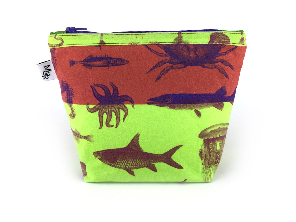 Handmade sea creature print makeup bag in rust and lime green