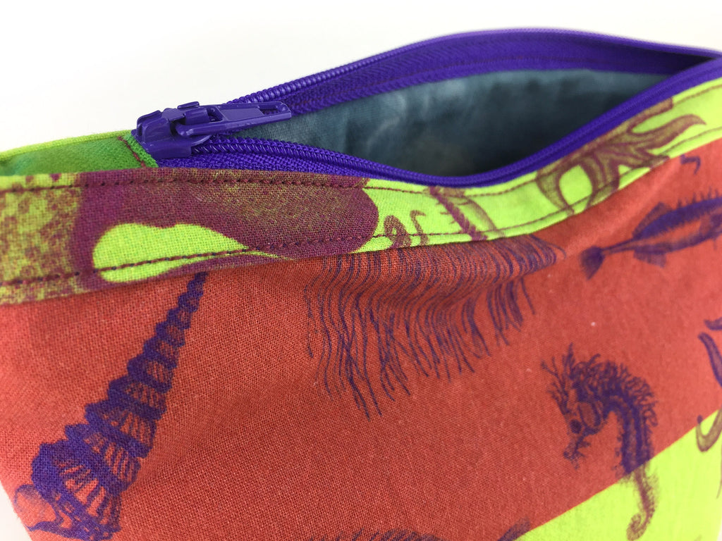 Max and Rosie handmade sea creature print wash bag in rust and lime green