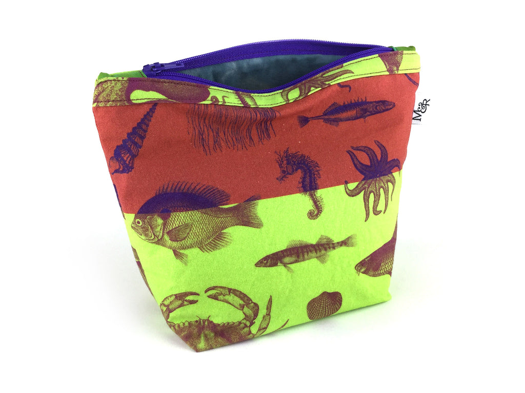 Handmade sea creature print wash bag in rust and lime green