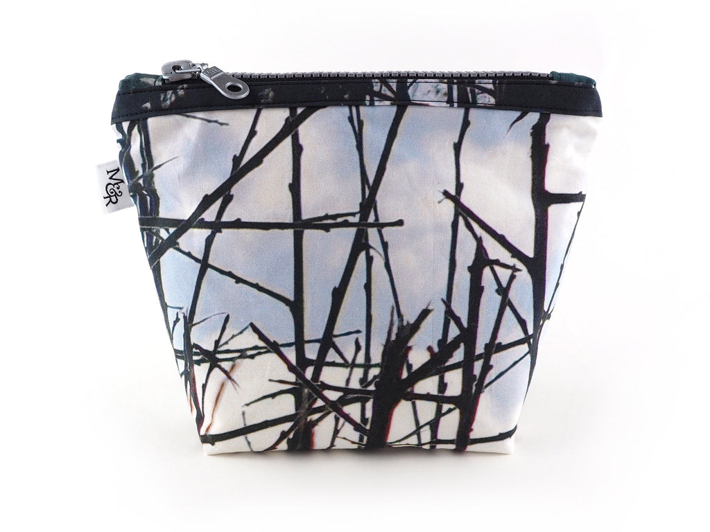 Handmade thorn print bag with silver zipper