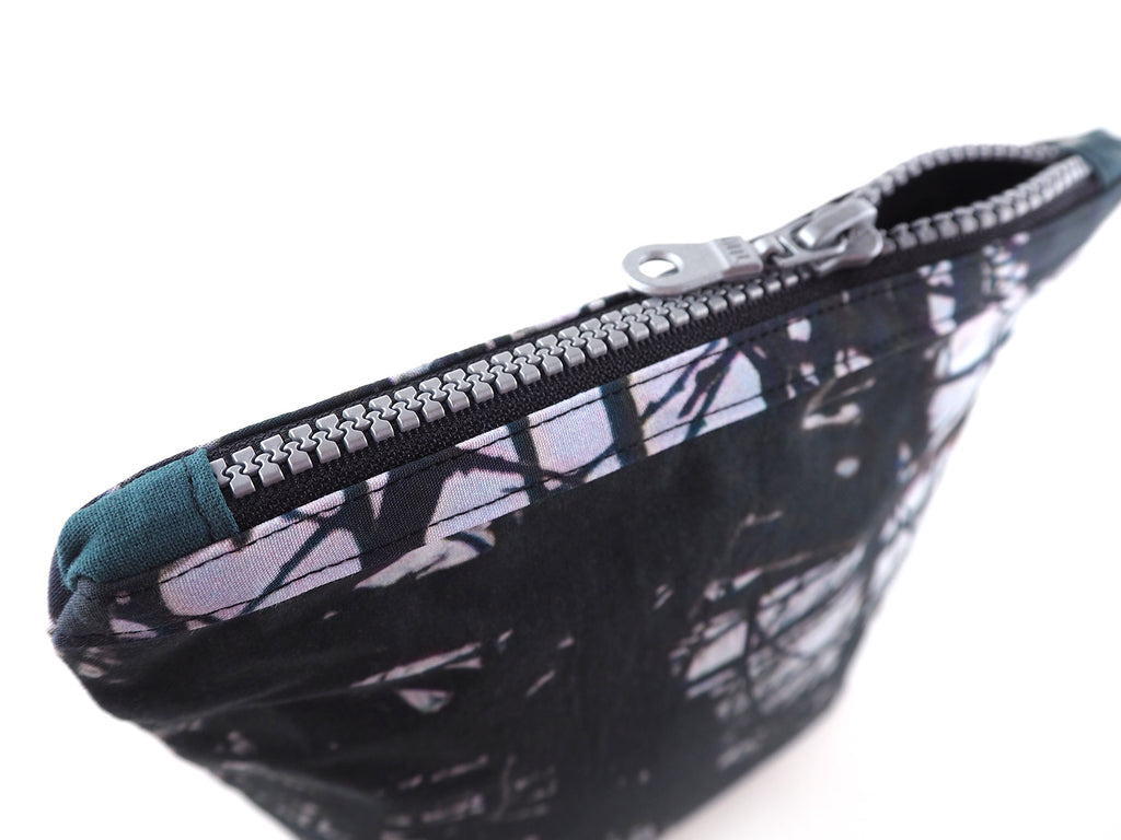 Handmade monochrome thorn print bag with chunky zip
