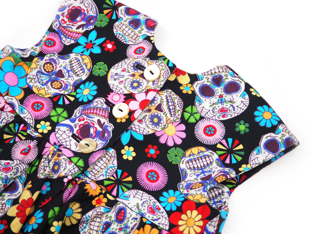Button detail on the skull print dress