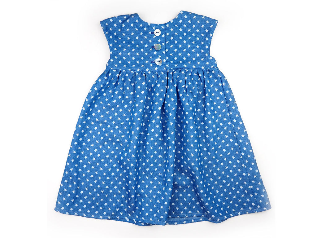 Back view of handmade girl's dress in blue fabric with star print