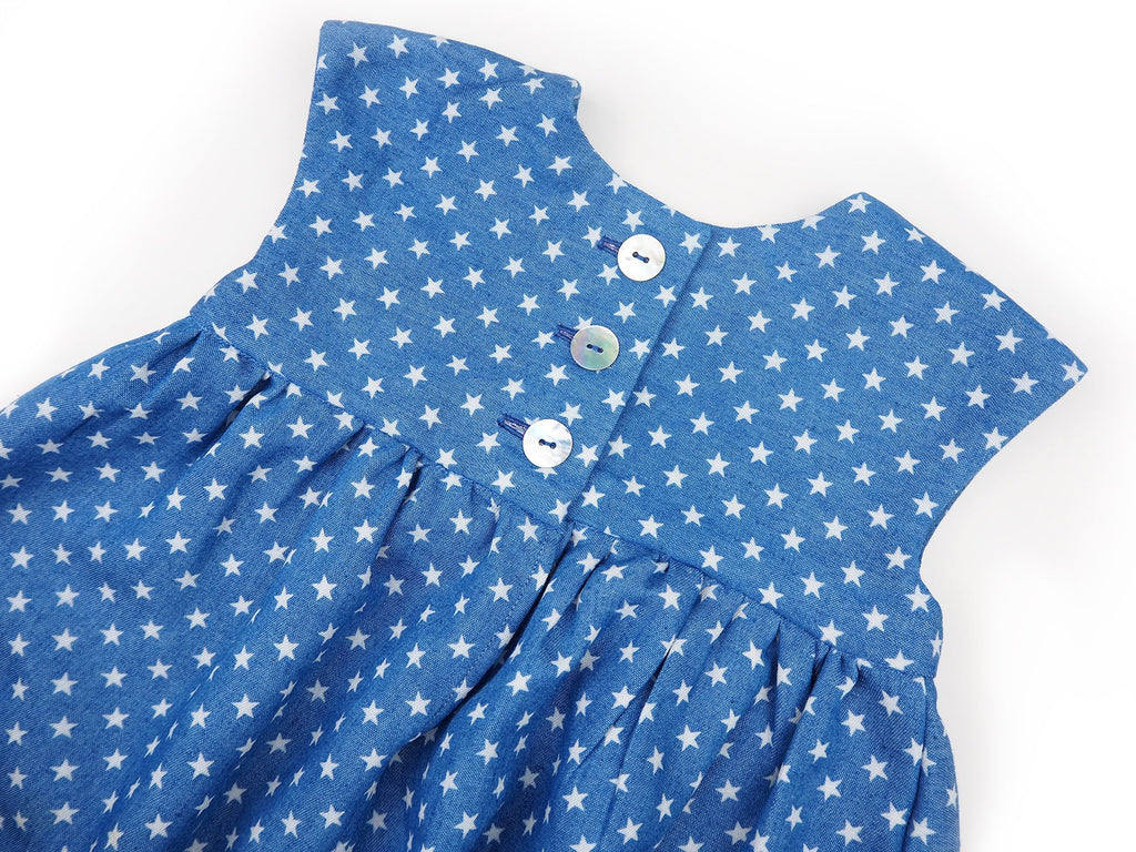 Handmade girl's dress in blue and white fabric with star print