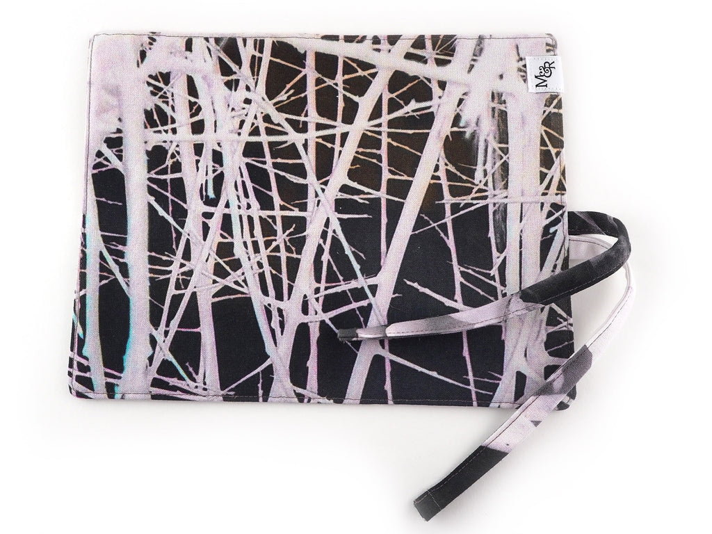 Handmade thorn print brush and pencil roll outside