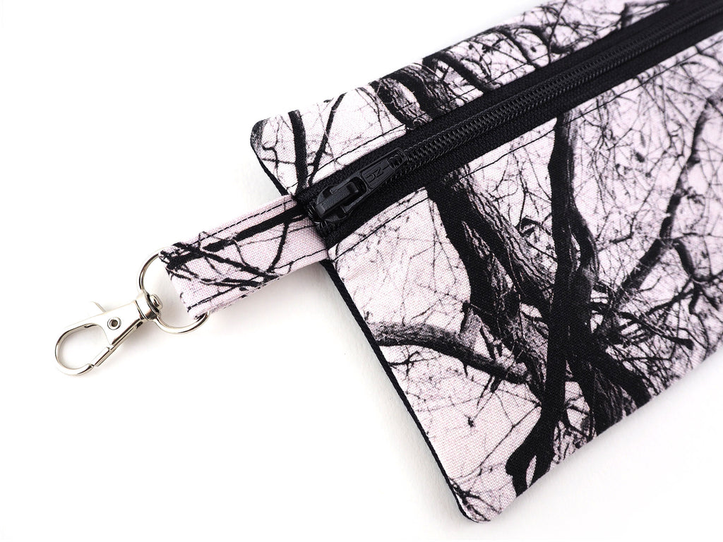 Monochrome tree print travel pouch with clasp