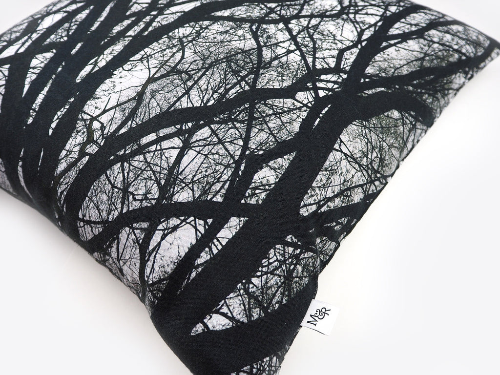 Monochrome tree print cushion detail