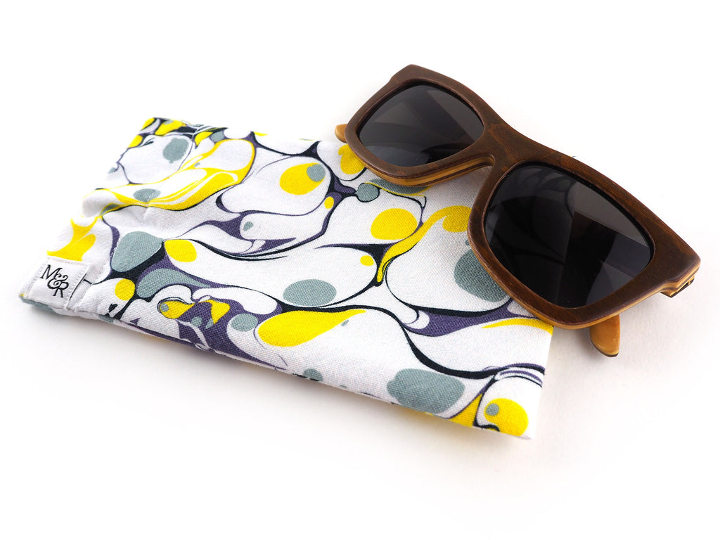 Handmade glasses case in yellow and grey marble print with sunglasses